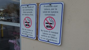 No smoking, in two languages, has been the policy at the Department of Human Services for a long time.