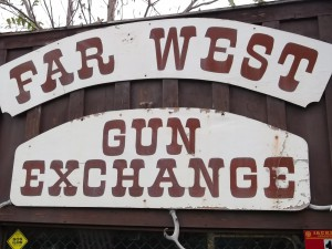 The sign outside a Southern Oregon antique store seems to frame the question: Exchange guns, but for what?