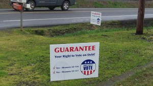 Campaign signs in favor of the proposal to require voter approval of new city debt: Ten years too late?