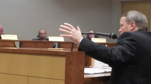 In a suit, Public Works Director Mark Shepard makes a point related to a 2 per cent water rate hike, which the council approved.