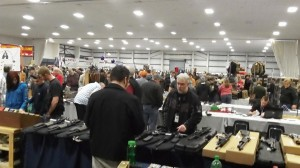 Checking the merchandise at an Albany gun show.