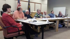 The council at a work session in April. Monday's agenda includes a health care issue.