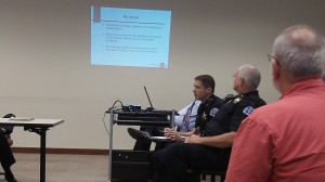 Police Chief Mario Lattanzio, left, and Lt. Casey Dorland talk to the council Aug. 12.