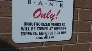 This sign cites the law on towing from private parking facilities.