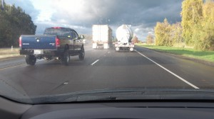 One truck going just below 55 mph makes another go around it on I-5.