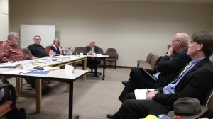 Council members talk with City Attorney Jim Delapoer, second from right, at Monday's work session.