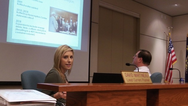 Stephanie Marcus makes her presentation as planner David Martineau watches.