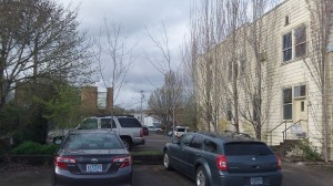 Four townhouses are planned for the lot on the other side of these cars.