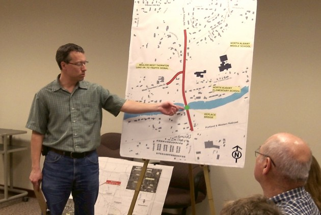 On a map of the N. Albany Road project, city engineer Chris Cerklewski points to a bridge that will have to be  replaced.