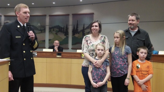 Fire Chief John Bradner with Mark and Andrea Ylen and their children, Maija, 10; Anika, 8, and Jakob, 5.
