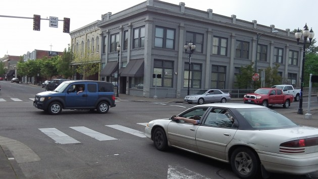 Drivers take turns while the signal at First and Ellsworth is out Monday evening.