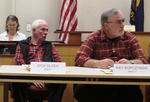 Councilor Olsen (with Councilor Kopczynski, right) at a meeting in February.