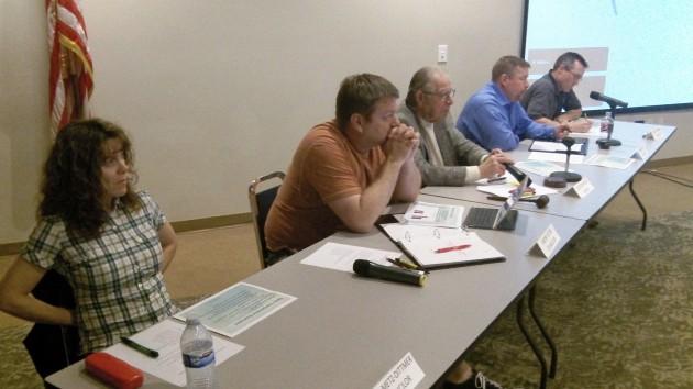 Council members Lisa Metz-Dittman, Jason Yutzie, Mayor Clayton Wood, Darrin Lane and Scott Cowan listen.