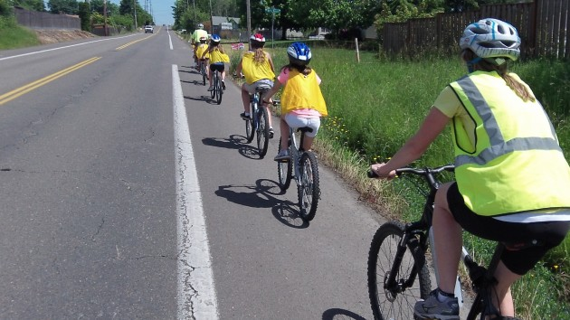 With adults front and back, another group chugs up the road.