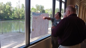 Councilor Rich Kellum and others study a map of CARA projects made by Tom Cordier, a critic of the program.