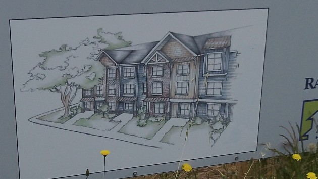 Sign shows off the concept of the new Woodland Square.