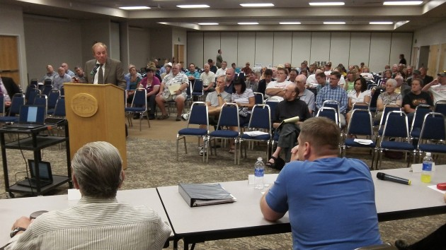 Consultant Gary Saleeba ticks off what he believes the advantages of a municipal utility to be.