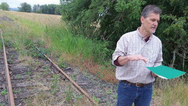 Benton Parks Director Jeff Powers explains that near Greenberry Road, the rail line forms the west boundary of the Finley Wildlife Refuge.