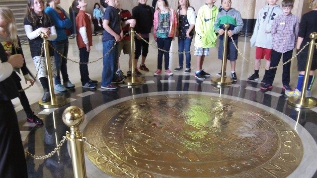 Visitors tour the Capitol, where the property  tax limit my become a target in 2015.