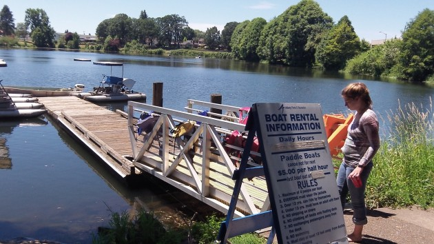 A sign board lists the rules for paddle-boating on Waverly Lake.