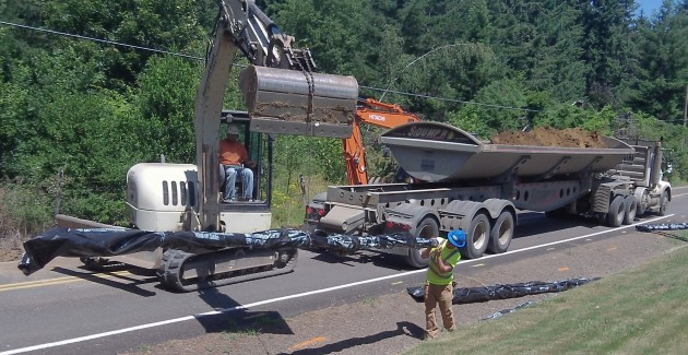 New water pipe being lifted into place on Powers Avenue.