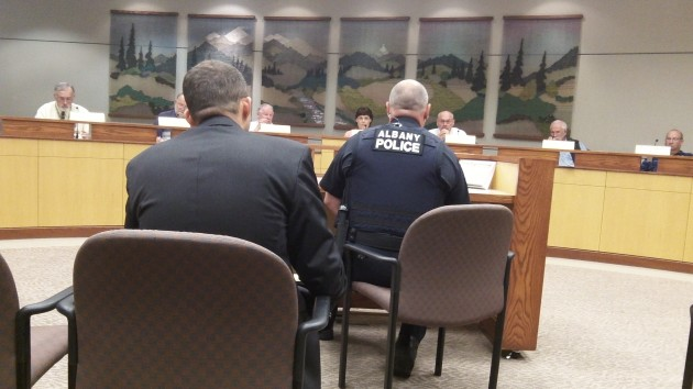 The seating arrangement for people (here, Police Chief Mario Lattanzio, left, and Det. Steve Dorn) addressing the council.