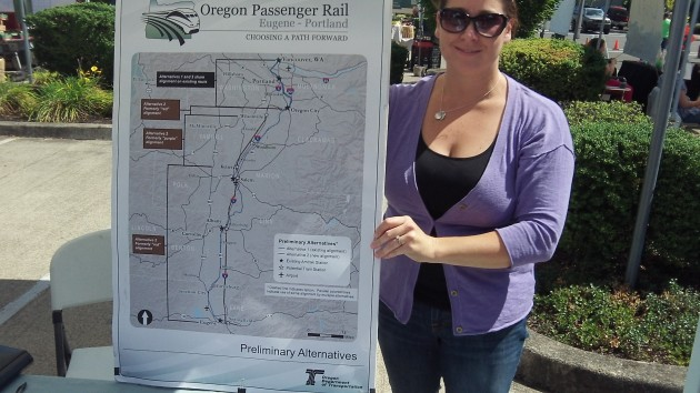 Amber Williamson was fielding questions about Oregon Passenger Rail at the Albany Farmers Market.