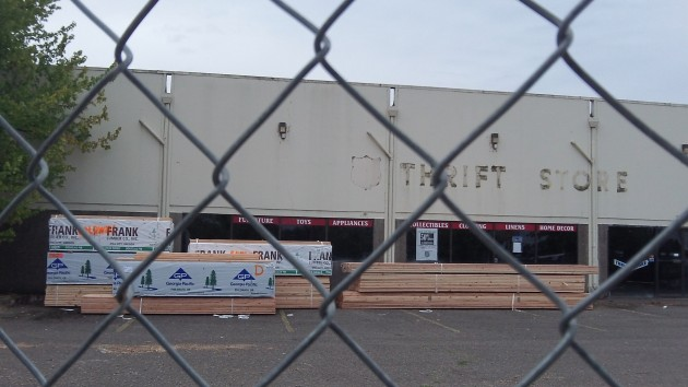 Construction fencing has gone up around the old Salvation Army thrift store.