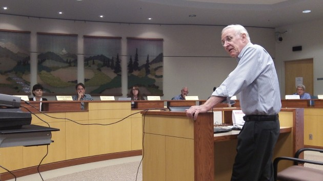 Architect George Crandall, the father of Albany's 1995 Town Center Plan, answers Kellum.
