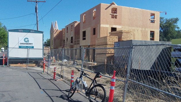 Woodland Square apartment buildings are rising fast along Second, east of Pine.