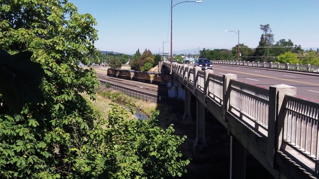 The overpass crosses what now is the Union Pacific mainline and other tracks.