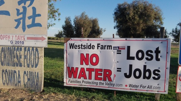 Signs like this remind travelers of the California water situation.