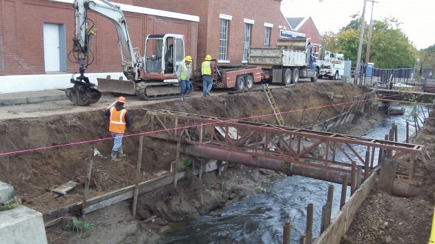 A contractor, Tornado Soft Excavation, works on a $265,942 project to repair the banks of the canal outside the Vine Street water treatment plant in Albany Tuesday.