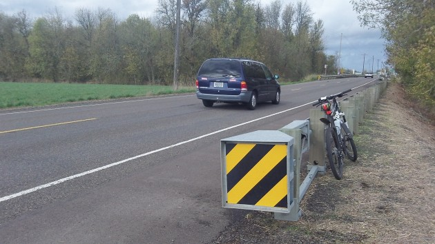 A guardrail end terminal on Highway 99E south of Tangent.