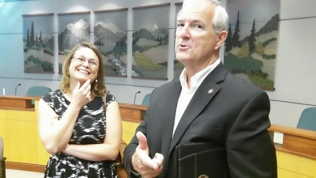 Sara Gelser has to laugh as Andy Olson makes a crack about having his picture taken after a campaign forum in September.