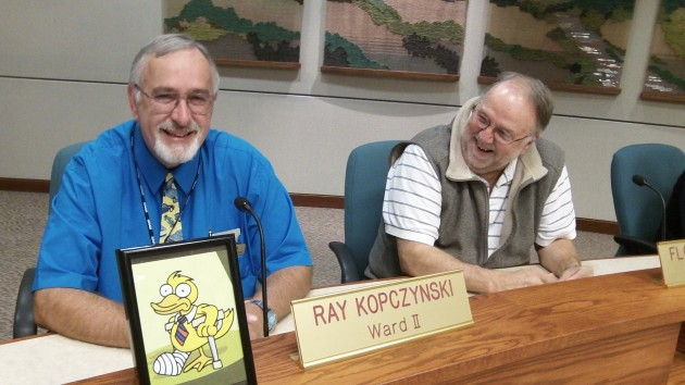 """Councilors Ray Kopczynski, left, and Floyd Collins share a laugh about Kopczynski's """"lame duck"""" status."""