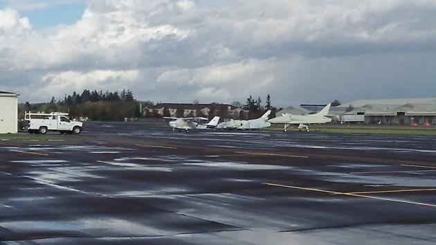 Vintage fighter jets await further restoration on the tarmac.