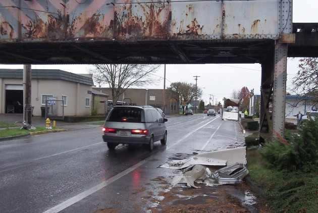 Wreckage lies under the railroad trestle on First Avenue.