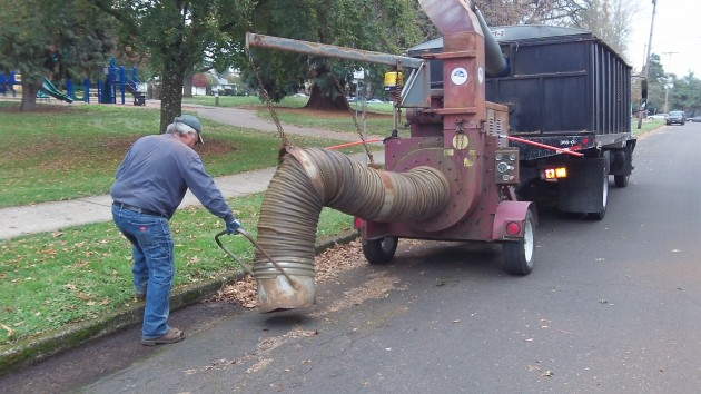The vacuum crew does Lawnridge Street at Takena Park on Wednesday.