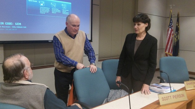 Mayor Sharon Konopa talks with Councilor Floyd Collins, seated, and budget committee member Will Summers Thursday.