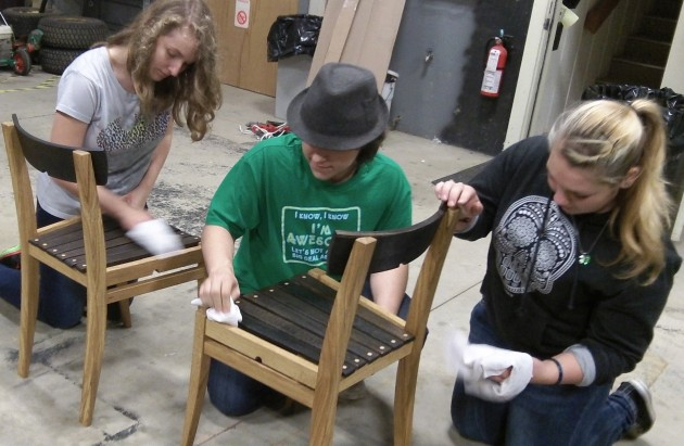 Oak chairs get more wax. From left are South Albany High School students Madison Wiseman, Karstan Peck and KaySea Hoffman.