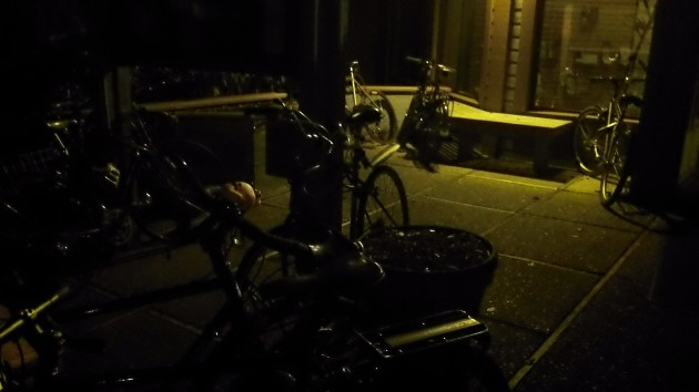In the dark, bikes  are parked outside the hearing venue,