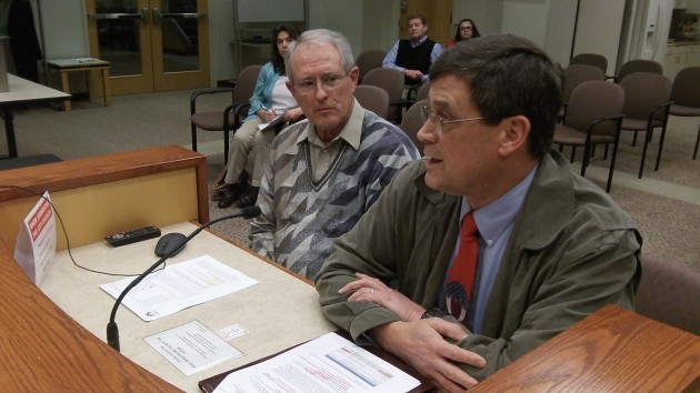 Frank Morse, left,  and Dave Burright ask the council to accept their  committee's report Wednesday.