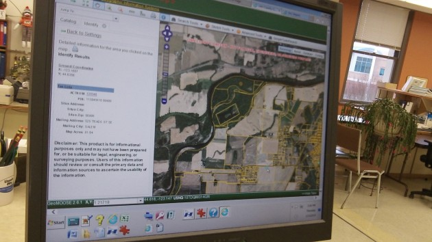 At the Linn County Assessor's Office, a screen shows an aerial of Powers Rock and surrounding fields.