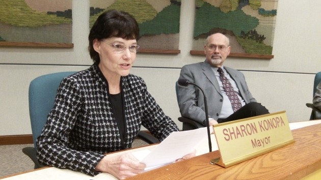Albany Mayor Sharon Konopa reads her annual message while City Attorney Jim Delapoer listens.