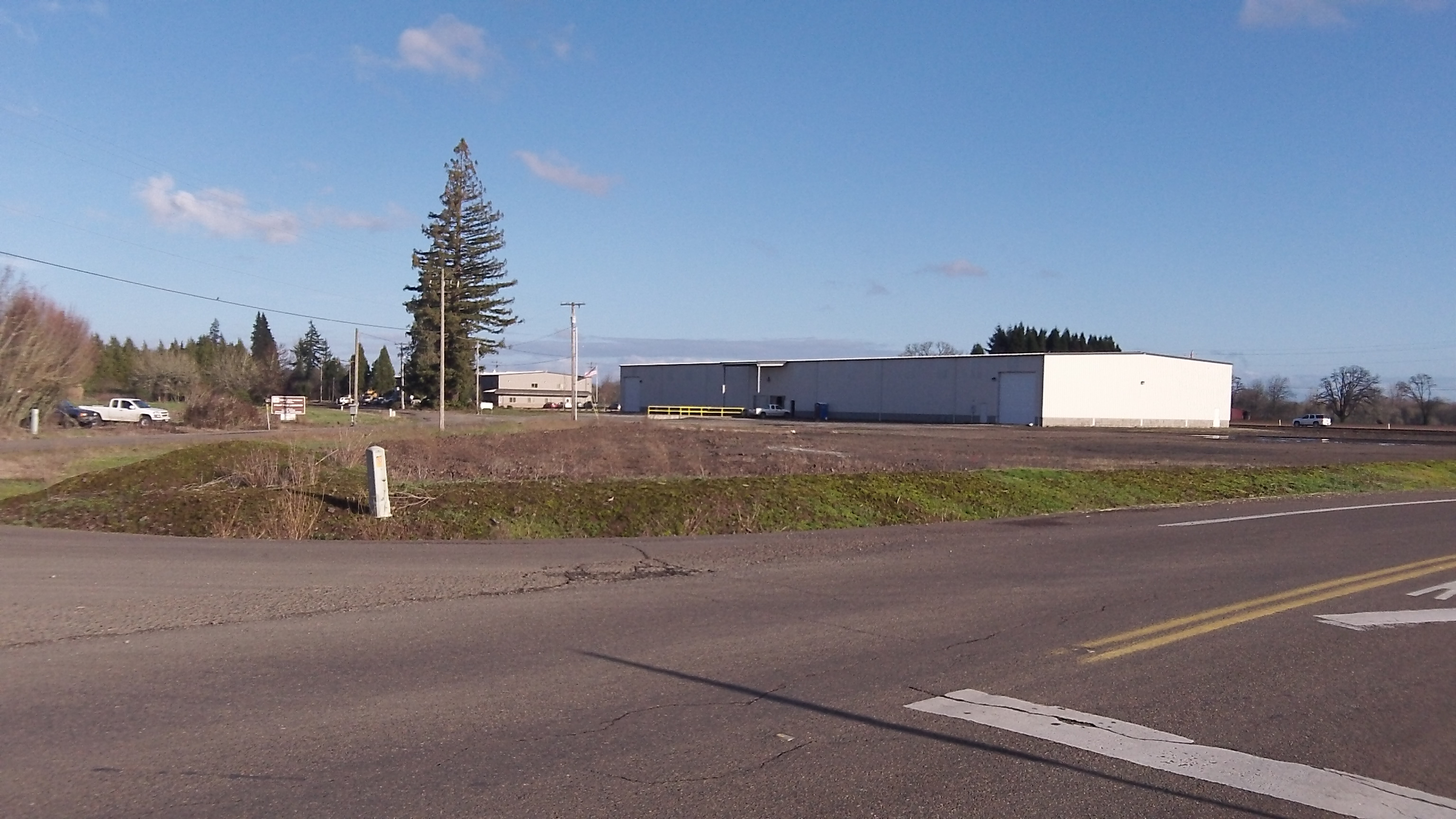 At Granger and Hyslop Roads, the path would skirt the warehouse in the background.