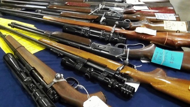 Rifles on display at an Albany gun show in March 2014.
