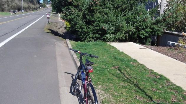 Why extend that dead-end sidewalk when Crocker Lane has wide shoulders like that?