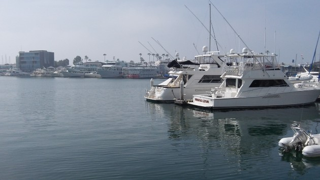 Daylight saving time in March makes no difference on the calm waters of Newport Beach, Calif.