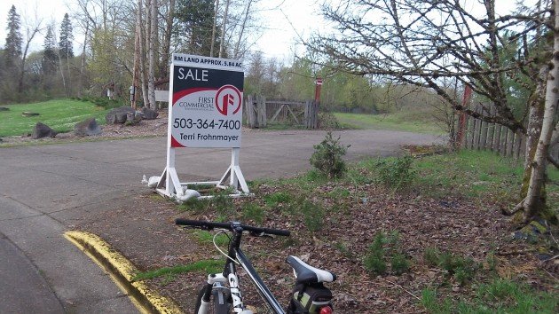 A for-sale sign has appeared where an apartment complex had been proposed.